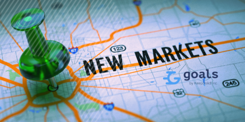 New Markets Concept - Green Pushpin on a Map Background with Selective Focus.